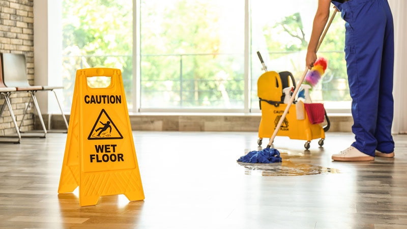 safety sign caution wet floor and cleaner